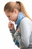 stock photo of respiratory disease  - portrait of an young woman coughing with fist - JPG