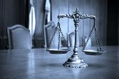 stock photo of symbol justice  - Symbol of law and justice law and justice concept focus on the scales blue tone - JPG
