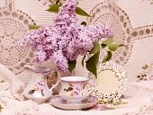 Vintage teacup with spring flowers and grape