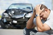stock photo of injury  - Adult upset driver man in front of automobile crash car collision accident in city road - JPG