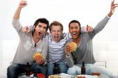 picture of takeaway  - Friends watching a football game together - JPG
