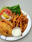 foto of hogfish  - unhealthy meal with fried fish sandwich and fries - JPG