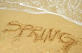 image of spring break  - A warm tropical beach for spring break concept and spring written in the sand - JPG