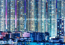 stock photo of overpopulation  - Overpopulated modern building in Hong Kong at night - JPG