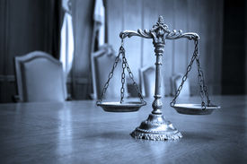 stock photo of jury  - Symbol of law and justice law and justice concept focus on the scales blue tone - JPG