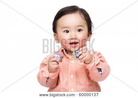 Asian baby boy play with toy block