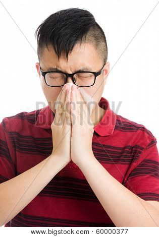 Asian man sneeze