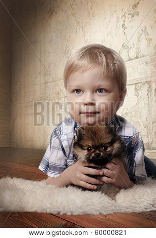 Adorable boy with Spitz puppy