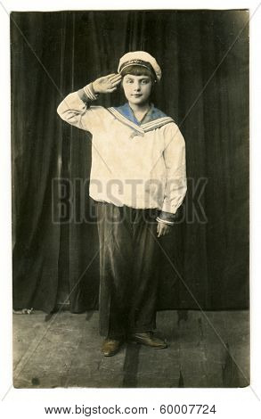 MOSCOW, RUSSIA - CIRCA 1913: An antique photo shows studio portrait of teenage girl in a sailor uniform