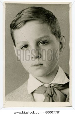 KURSK, USSR - CIRCA 1970: An antique photo shows portrait of a 14-15 years old teenager boy.