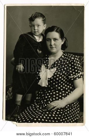 KIEV, UKRAINE, USSR - CIRCA 1964: An antique photo shows studio portrait of a young mother and her little son.