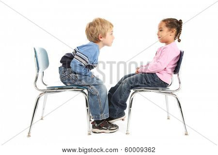 Little boy and little girl having a staring contest