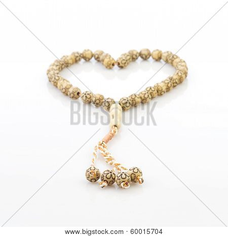 heart shape of rosary isolated on white background
