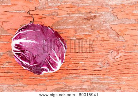 Variegated Radicchio On Grungy Rustic Wood