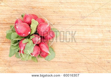 Bunch Or Red Radishes On A Bamboo Board