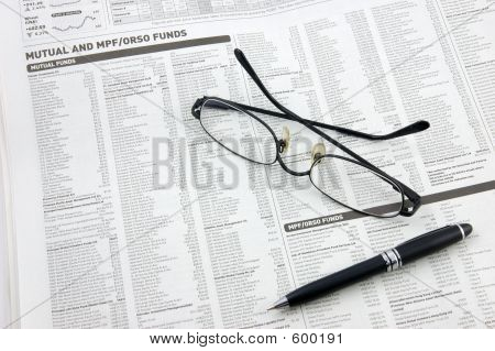 Glasses, Pen And Mutual Funds On Newspaper