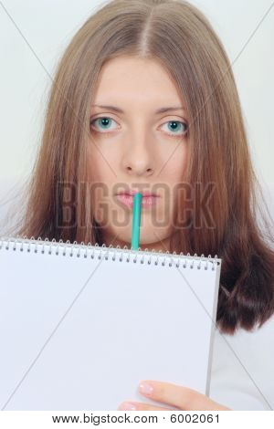 Cute Girl With Notebook And Pencil