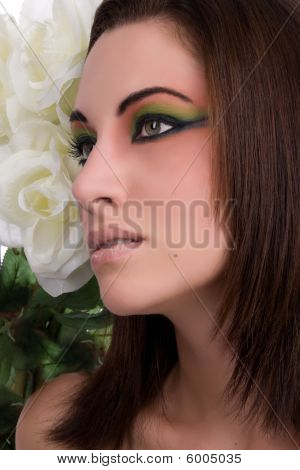 Close-up Of Young Beautiful Woman With White Flower
