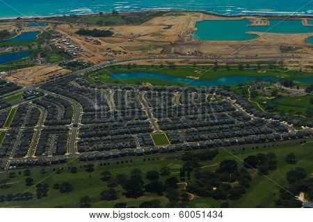 Aerial View Of Tropical Beach And Suburb