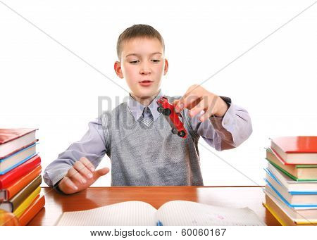 Schoolboy Plays With A Toy
