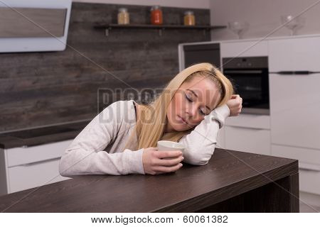 Tired in the kitchen
