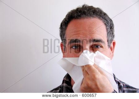 Sick Man Blowing Nose