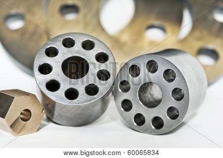 Metal Flanges Cylinders And Brass Nuts.