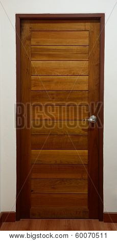 wood door in bedroom