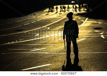 MOSCOW - JUNE 13, 2013: Silhouette of road policemen regulating traffic jam on the city center. Moscow Mayor Sobyanin reconstructs suburban railways, to solve problem of traffic jams in 2016.