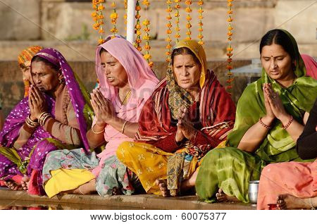 Senior Women Perform Puja - Ritual Ceremony Holy Pushkar lake,India
