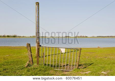 Gate With Scale Of Waterlevel In Floodplain Of The Ijssel, The Netherlands