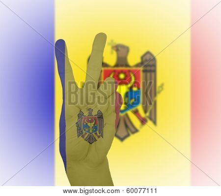Hand Peace Sign With Flag Of Moldova
