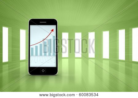 Arrows and barchart on smartphone screen against bright green room with windows