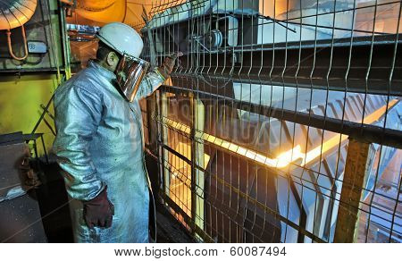 industrial worker and furnace in steel factory