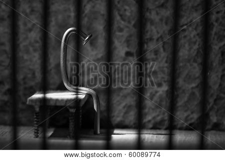 Conceptual Jail Photo With Iron Nail Sitting Behind Bars Artistic Conversion