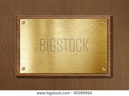 golden or brass plate for nameboard or diploma background in wooden frame