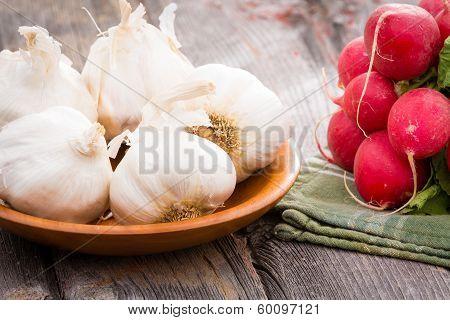 Fresh Whole Garlic Bulbs With Radishes