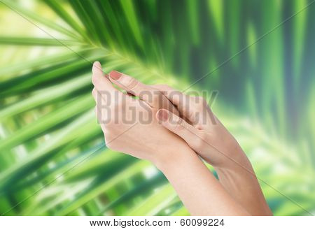 body parts, conspetics and spa concept - close up of female soft skin hands
