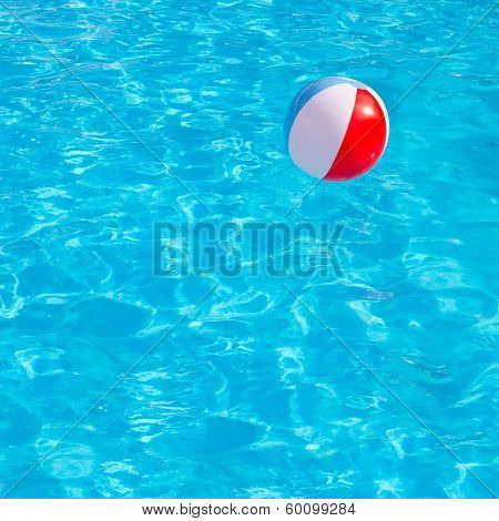 Inflatable colorful ball floating in swimming pool