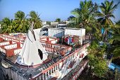 picture of wigwams  - White wigwam on the hotel roof at blue sky and tropical background in Mamallapuram Tamil Nadu India - JPG