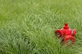 picture of hydro  - Hydro waterpump in a field of grass