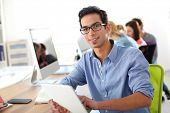 stock photo of business class  - Student in class using digital tablet - JPG