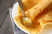 stock photo of millet  - Gluten free crepes from rice flour potato starch and millet flour with honey - JPG