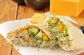 stock photo of alfalfa  - Pita sandwich with alfalfa sprouts avocado cheddar cheese - JPG