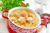 stock photo of stew pot  - Meat stew in sour cream sauce in a pot - JPG