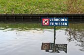 foto of dock a pond  - no fishing sign in a small pond - JPG
