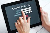stock photo of touching  - Female hands using online banking on touch screen device - JPG