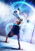 stock photo of break-dance  - Young man break danceing on wall background - JPG