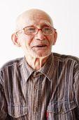 Portrait Of Senior In Eyeglasses