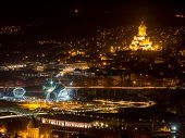 stock photo of trinity  - Tbilisi seen from Fort Narikala with the The Holy Trinity Cathedral by night - JPG